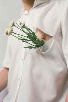 man in white button up shirt with white flowers